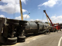 Recovering a rolled over tractor and trailer in Rochester NY