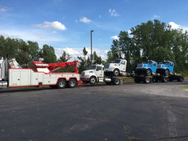 Sliding rotator towing decked tractors in Rochester -585-865-8159