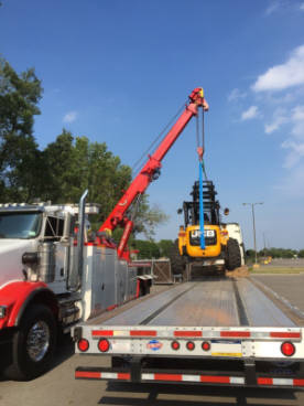 Kerhaert's Towing of Rochester NY using 50 ton rotator.