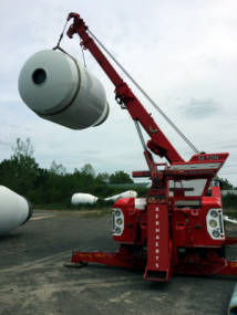 Kerhaert's of Rochester NY lifting a cement drum with 50 ton sliding rotator.